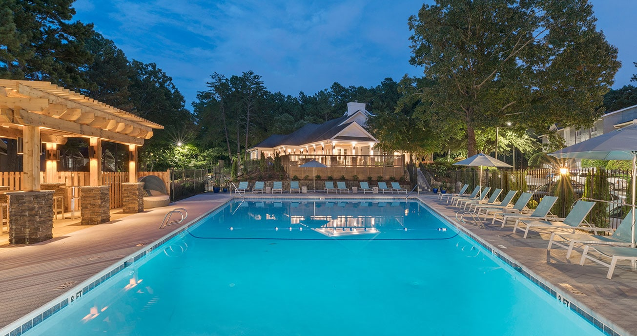 outdoor pool with clubhouse and chairs, 550 Abernathy, atlanta ga